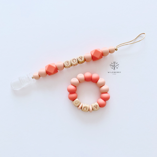 Wildberry Word Teether Strap- Coral